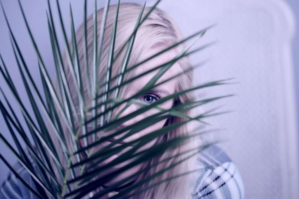 Hiding behind a plant